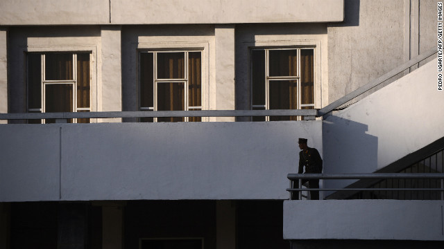 A North Korean soldier stands on a balcony in Pyongyang in April 2012.