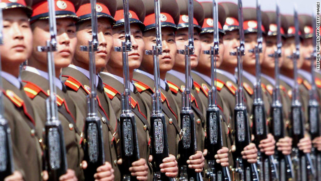 A North Korean military honor guard stands at attention at Pyongyang's airport during a diplomatic visit on May 2, 2001.