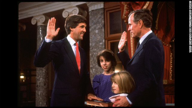 Vice President George H. W. Bush swears in Kerry after he won his first Senate seat, as Kerry's daughters Alexandra, second left, and Vanessa look on in 1985.