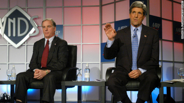 Kerry answers a question from an audience member while former Vermont Gob. Howard Dean listens at a forum of AARP members on November 18, 2003, in Bedford, New Hampshire.