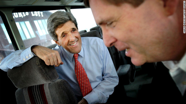 Kerry jokes with Iowa Gov. Tom Vilsack before speaking to supporters at Jerry's Restaurant on December 14, 2003, in Mt. Plesant, Iowa.