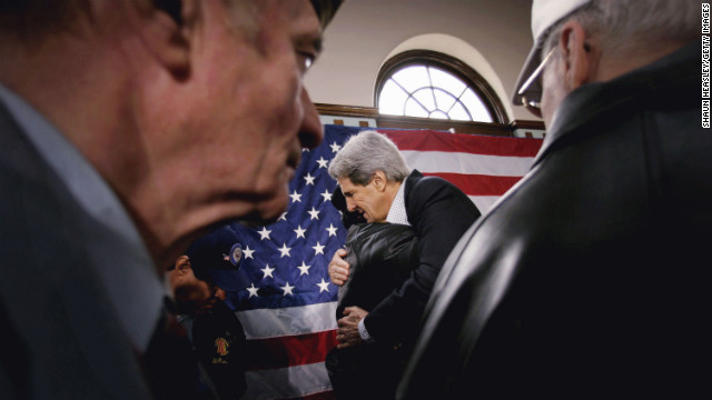 Kerry and a veteran embrace at a town hall meeting at the Black Hawk County Soldiers Memorial Hall on January 13, 2004, in Waterloo, Iowa.
