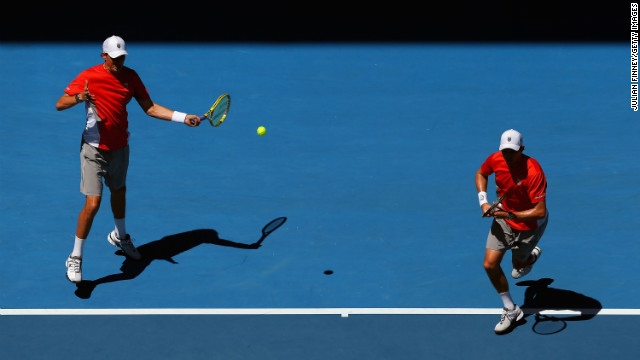 Brothers Bob, left, and Mike Bryan battle Simone Bolelli and Fabio Fognini of Italy in a doubles semifinal match on January 24. The brothers won 6-4, 4-6, 6-1.