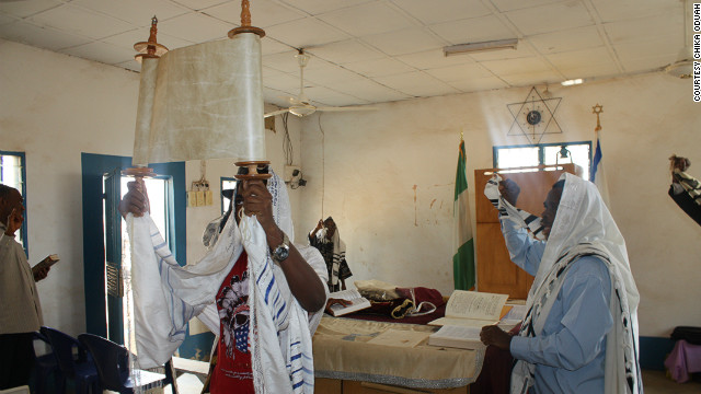 Honoring the presentation of the Torah at a synagogue near Abuja.