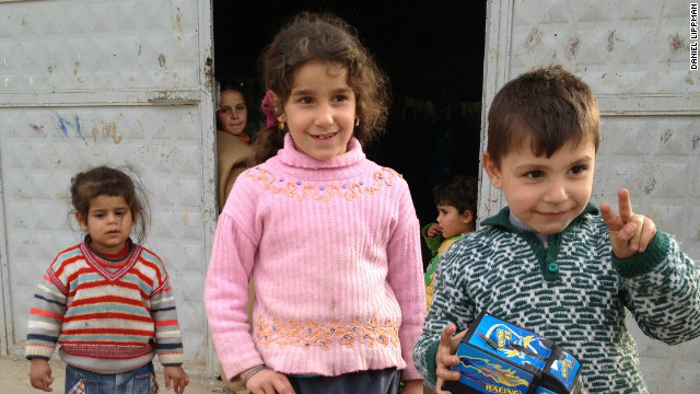 Refugee children outside a building housing displaced Syrians in the Turkish border town of Hacipasa.