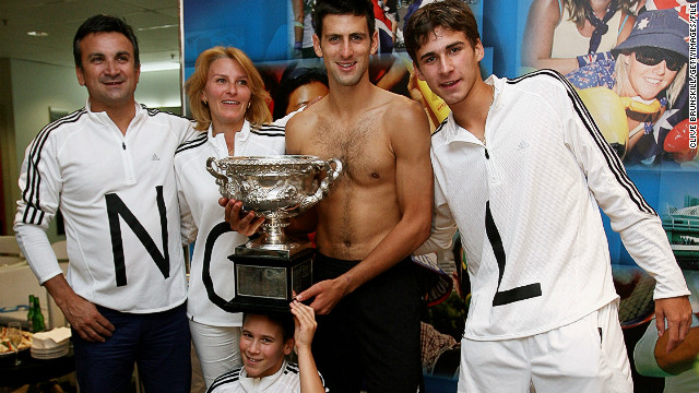 The Djokovic family celebrate his 2008 Australian Open title in the locker room. Speaking to CNN about his time growing up in Serbia, Djokovic said: &quot;It was really hard to succeed and I have to thank God for the big support from my father and my mother and all the family. They believed in me ... &quot;