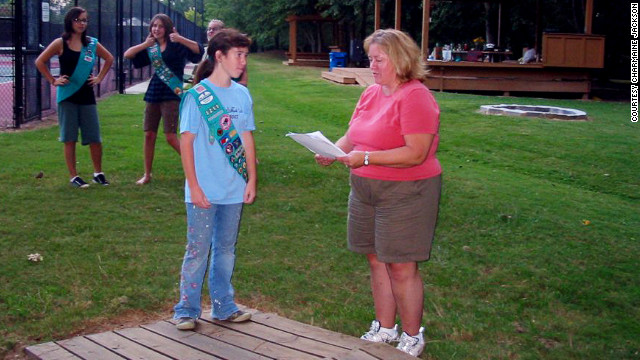 Jackson attends a Girl Scouts ceremony with her daughter in September 2007. She had just received news that she would be laid off from her job in December. She remembers being uncomfortable wearing shorts in public.