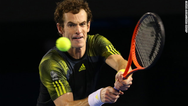 Andy Murray of Great Britain plays a backhand in his semifinal match against Roger Federer of Switzerland on January 25. Murray defeated Federer 6-4, 6-7 (5-7), 6-3, 6-7 (2-7), 6-2. 