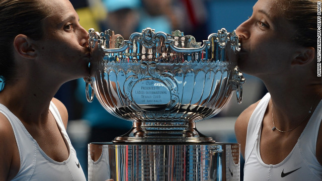 Italy's Roberta Vinci, left, and Sara Errani pose with the winner's trophy after their victory over Australia's Ashleigh Barty and Casey Dellacqua on January 25.