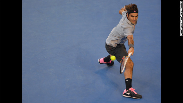 Roger Federer hits a return on January 25.