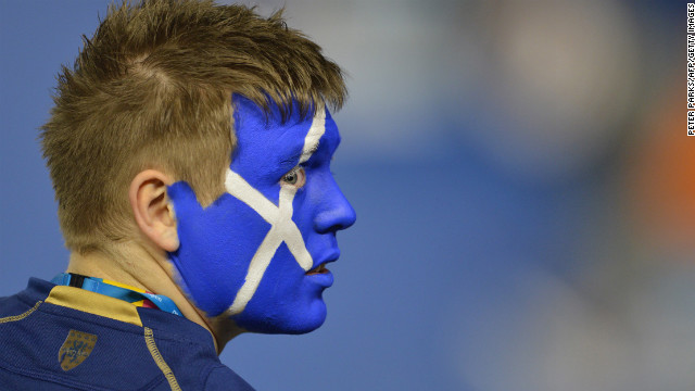 A supporter of Britain's Andy Murray watches during his men's singles semifinal match against Switzerland's Roger Federer on January 25.