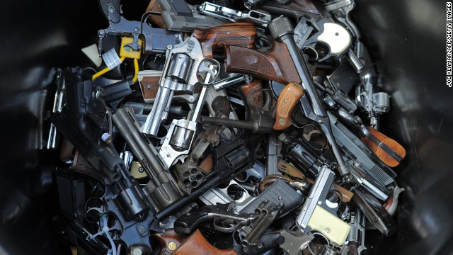 A trash bin of handguns collected during a gun buyback program in Los Angeles last month