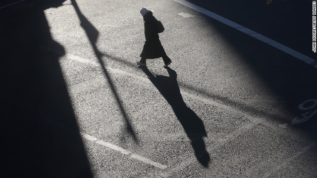 A lone pedestrian braves the winter chill on a Manhattan street on Thursday, January 24.