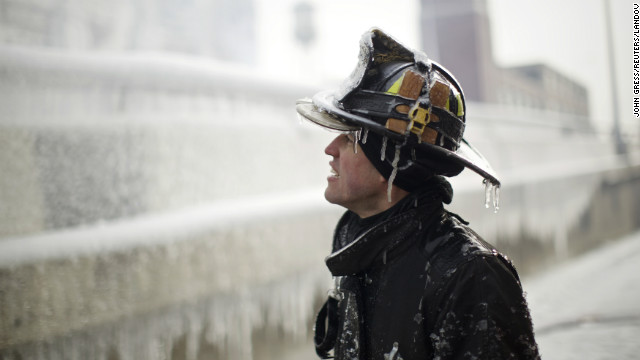 Ice covers firefighter Michael De Jesus while he mans a water cannon at the scene of a warehouse fire in Chicago on January 24.