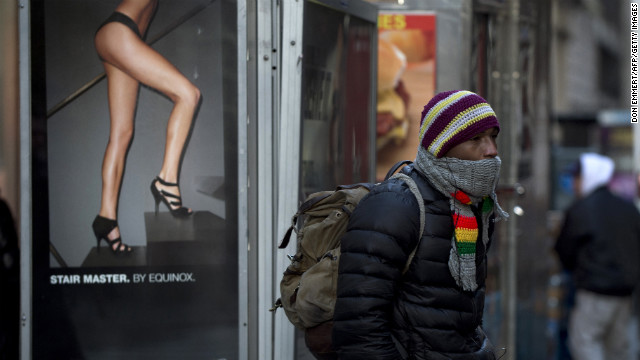 A man keeps bundled up as he waits to cross the street in New York on January 23.
