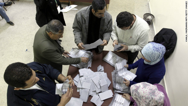 Jordanian election officials start counting votes in Amman on Wednesday.