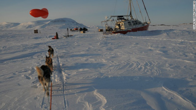 Husky dogs pull a sled on the pack ice near Spitzbergen, Norway. 