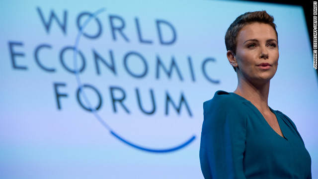 Theron gives a speech after picking up the 2013 World Economic Forum Crystal Award for her humanitarian work.