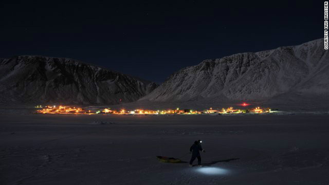 Eric Brossier pulls a sled through the snow near Grise Fiord. This year marks the first time his family have spent the winter months close to a human settlement.