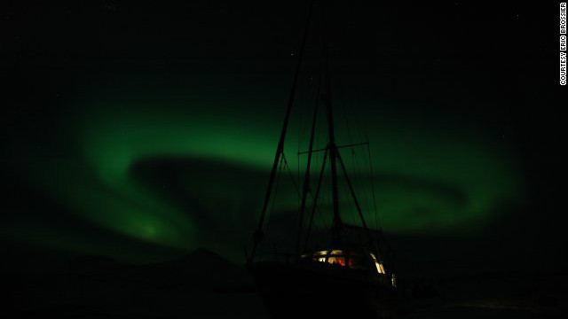 The swirling northern lights in the skies above <i>Le Vagabond</i> in Spitsbergen, Norway.