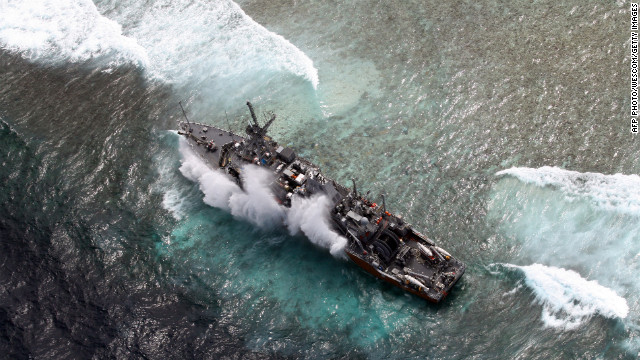Navy to cut up ship stranded on reef