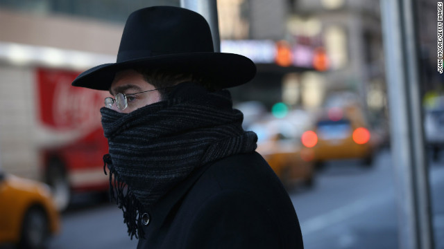 "A pedestrian bundled up against the cold walks through the streets of Manhattan on Friday, January 24, in New York City. Polar air settled in over the northeastern U.S. Wednesday, with temperatures in the teens and 20s. Forecasters warned that ""bitterly cold conditions"" were expected across much of the Northeast, Mid-Atlantic and Mideast through this weekend."