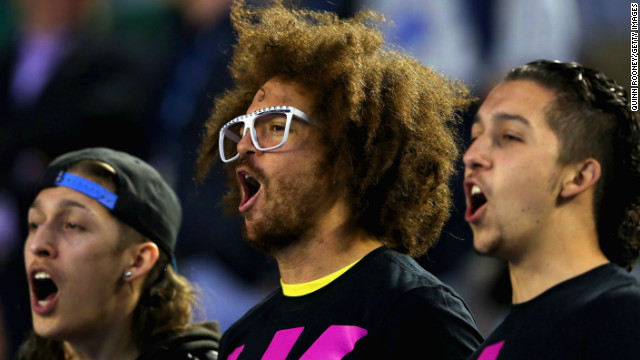 But Azarenka did have some support -- her boyfriend Stefan &quot;Redfoo&quot; Gordy (center), the son of Motown Records founder Berry Gordy and a pop star in his own right as a member of the band LMFAO.