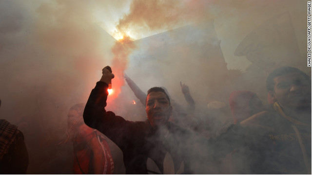 Egyptian fans of Al-Ahly football club rally outside the club's headquarters in Cairo on Saturday, January 26. An Egyptian judge sentenced 21 people to death Saturday for their roles in a football game riot last year, a ruling that sparked deadly clashes between security forces and relatives of the convicted.