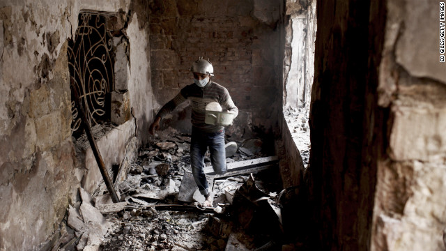 A protester walks through a damaged school building.