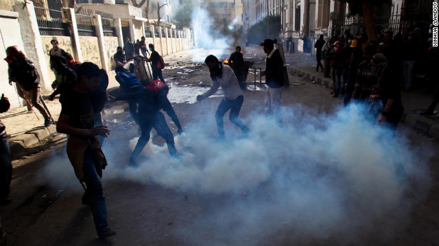 Protesters and football fans clash with riot police near Egypt's interior ministry.