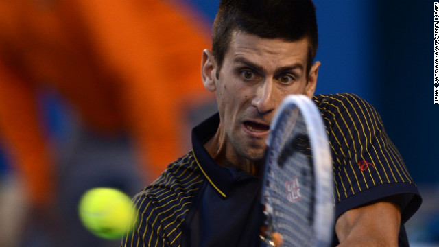 Djokovic hits a return against Murray on January 27.
