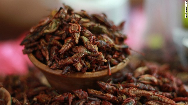 Lime- and chile-spiced chapulines are ready for sale in a market in Oaxaca. The grasshoppers are fried, seasoned and eaten as a snack.