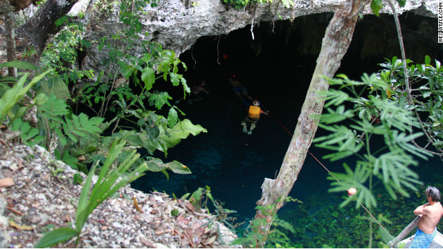 Grand Cenote near Tulum offers a shady oasis from the heat.