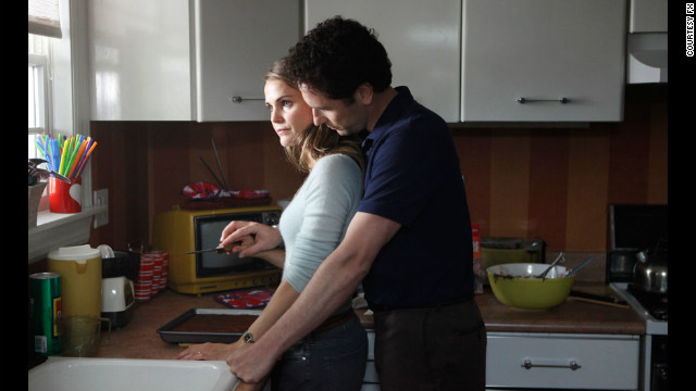 "Set in Reagan-era America, FX drama ""The Americans"" follows KGB spies, played by Keri Russell and Matthew Rhys, posing as an American couple in suburban Washington. The show has been renewed for a third season."