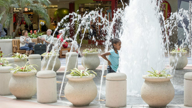 Children visiting the Orlando airport might get soaked playing in the fountain.