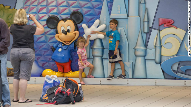 Orlando's airport ranked No. 1 for keeping kids entertained, as evidenced by Mickey Mouse's presence at the airport.