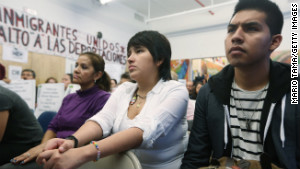 Oscar Rodriguez, right, sits with Yenny Quispe, at a \
