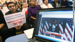Undocumented immigrant Katherine Taberes holds a sign during the watch party for President Obama\'s speech.
