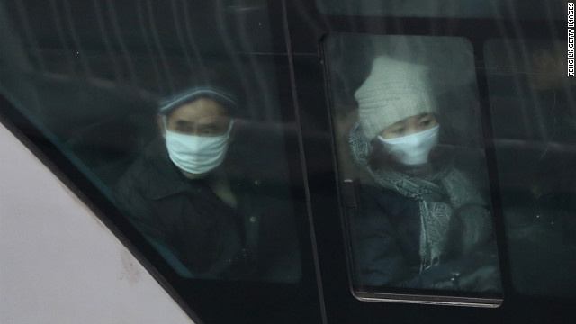 The pollution forces residents of Beijing to wear masks as they ride the bus on January 30.