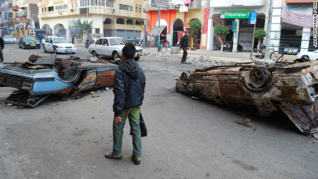 The following day, after the protest, burnt out cars remained in the street.