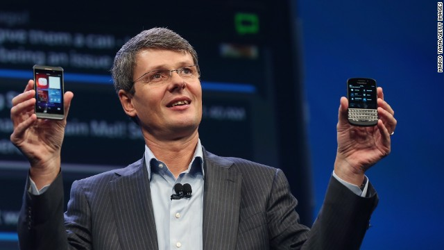 BlackBerry CEO Thorsten Heins displays the two new Blackberry 10 smartphones at the BlackBerry 10 launch event on Wednesday, January 30 in New York. The Z10, left, features an all-touch keyboard. The Q10 features a classic BlackBerry tactile keyboard.