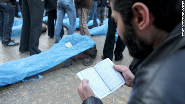 A man reads prayers for the dead.