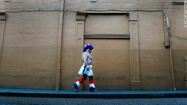 A man walks down the street in the French Quarter on January 28.