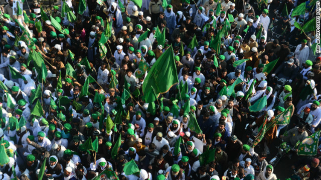 Pakistani Muslims march during a procession to mark the Eid Milad-un-Nabi (Birth of the Prophet) festival in Lahore on Friday.