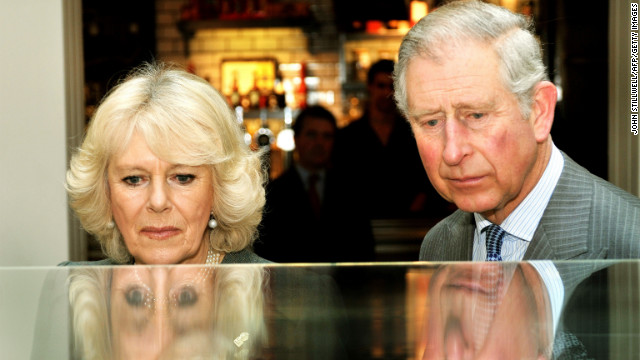 Britain's Prince Charles, Prince of Wales, and his wife Camilla, Duchess of Cornwall, study a model of the refurbished King's Cross train station during an event to mark 150 years of the London Underground on January 30. Charles is next in line to the British throne.