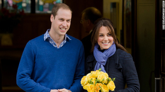 Britain's Prince WiIliam, the Duke of Cambridge, poses for pictures with his wife Catherine, Duchess of Cambridge, as they leave the King Edward VII hospital where the pregnant Catherine was admitted for treatment for acute morning sickness.