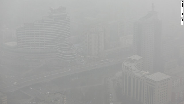Skyscrapers in Beijing can be seen through severe smog on January 30.