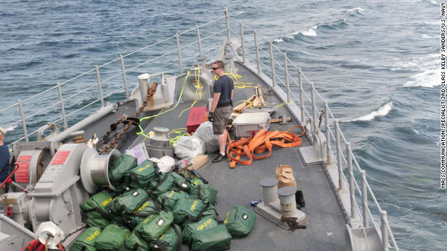 In this undated photo, a U.S. Navy diver moves damage control equipment and other materials to be unloaded from the USS Guardian.