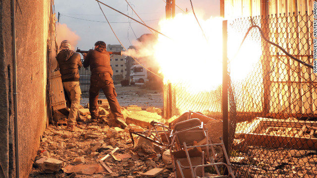 A rebel fighter fires a rocket-propelled grenade during heavy fighting.