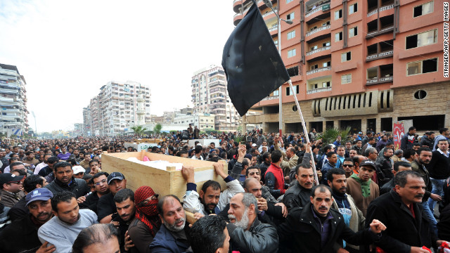 Mourners carry the coffins of six people killed in clashes after the soccer riot ruling in Port Said on Monday, January 28. Rage exploded when a judge sentenced to death 21 residents of Port Said for roles in a deadly 2012 soccer riot.